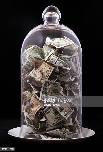 Paper Bills Under Glass