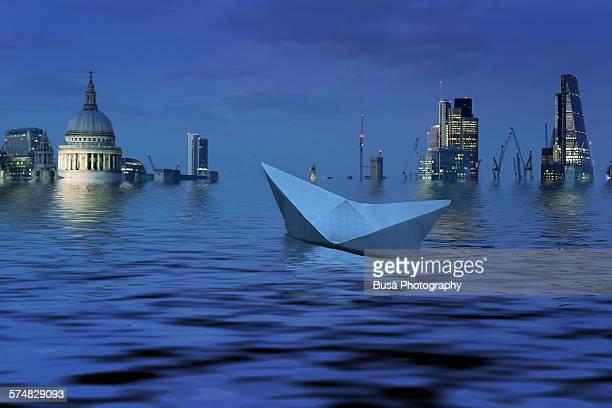 Paper boat adrift in a flooded London, UK