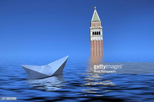 Paper boat adrift in a flooded Venice, Italy