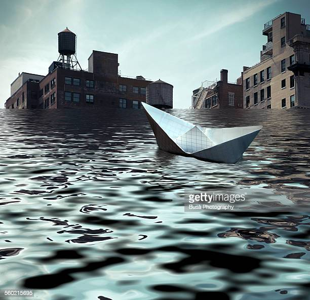 Paper boat adrift in the waters of a flooded NYC