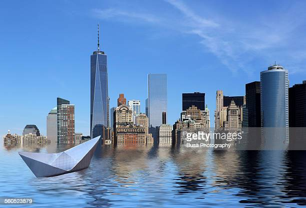 Paper boat drifting in a flooded New York City