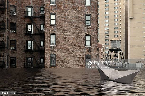 Paper boat drifting in the water of a flooded NYC