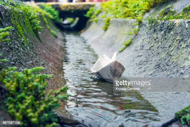 Paper Boat Floating After Rain