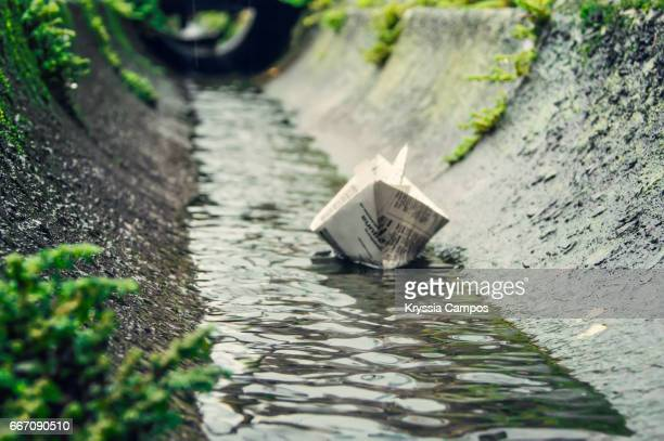 Paper Boat Floating After Rain Storm