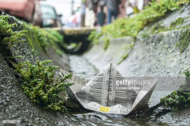 Paper Boat Floating in water
