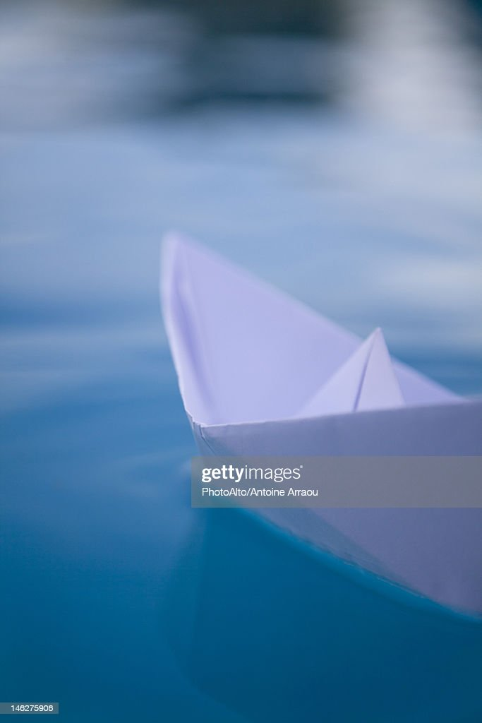 Paper boat floating on water : Stock Photo