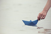 Female floating paper boat