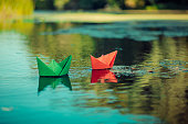 Paper boat on the river freedom wave