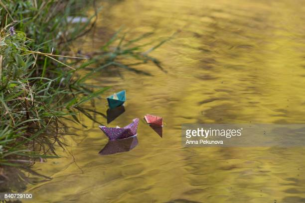Paper boats floating on a river