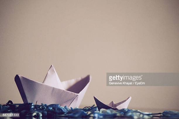 Paper Boats On Table