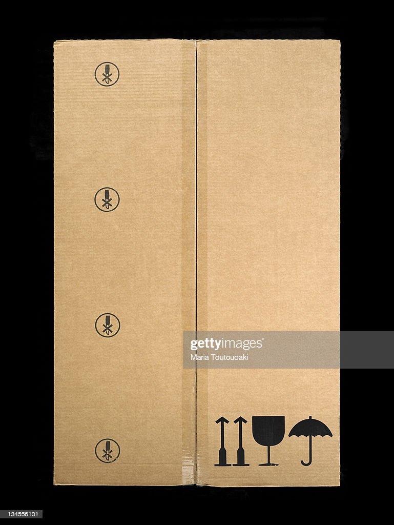 Paper box with symbols : Stock Photo