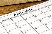 A paper calendar april 2018 on wooden background