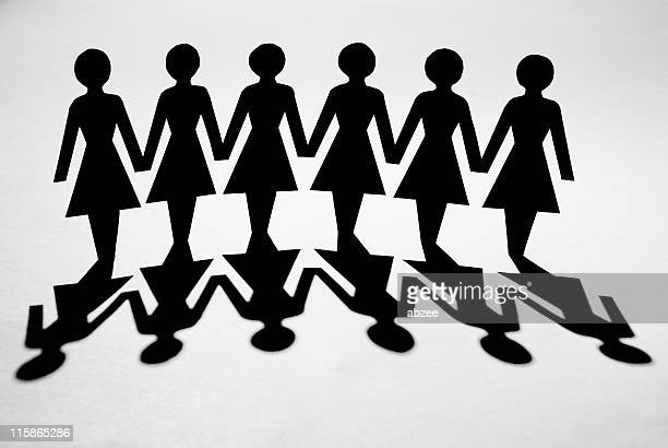 Paper chain of women with shadow