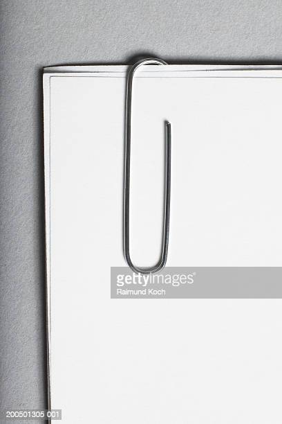 Paper clip holding three sheets of white paper