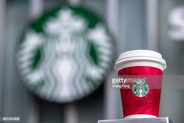 A paper coffee cup and Starbucks logo Starbucks will continue its expansion in China in 2015 and double its China store count to 3000 by 2019 In its...