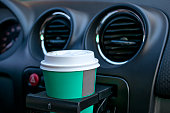 Paper coffee cups inside car cup holder