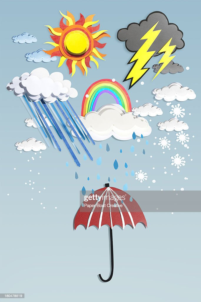 Paper Craft All Weather over a red umbrella : Stock Photo