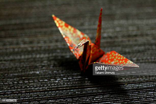 Paper crane made with patterned red chiyogami