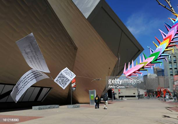 DENVER COA paper cubes with QR codes and flyers attached to it flies in the breeze in front of the Denver Art Museum Tuesday morning The cubes were...