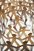paper cut out figure surrounded