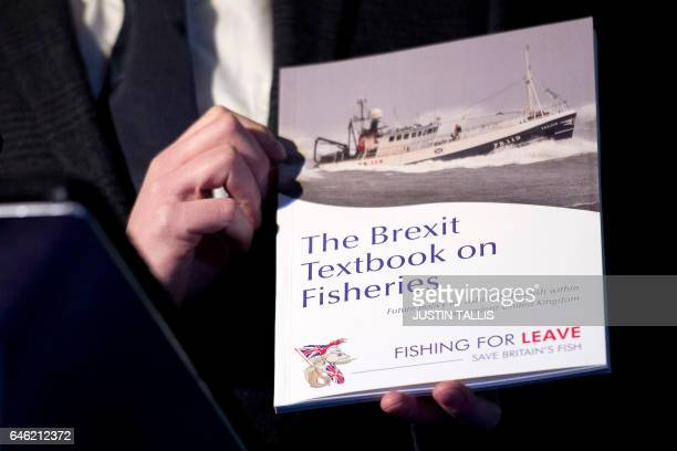 A paper entitled 'The Brexit Textbook on Fisheries' is pictured at a press conference on the impact of Brexit on the fisheries industry held by...