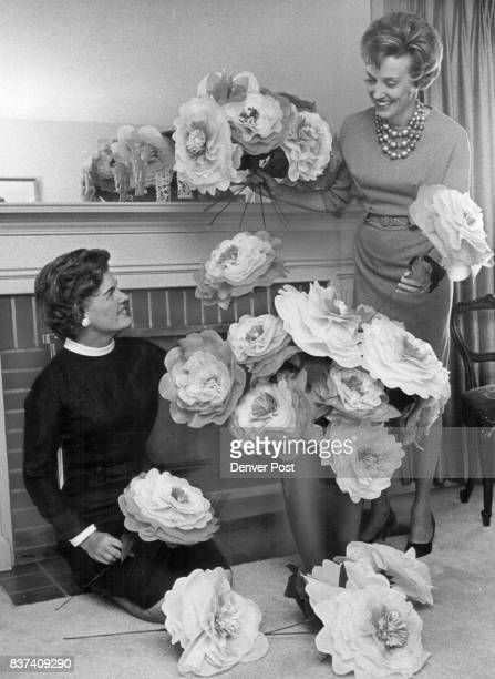 Paper flower bouguet is arranged by Mrs William T Ahlborg left ball chairman Mrs James C Dittmer who heads decorations Credit Denver Post