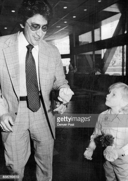 Paper Flowers For Friends At Mountain Bell Jimmy Speiser hands paper flower to costomer at Mountain Befl Jimmy was among first graders from Boulevard...