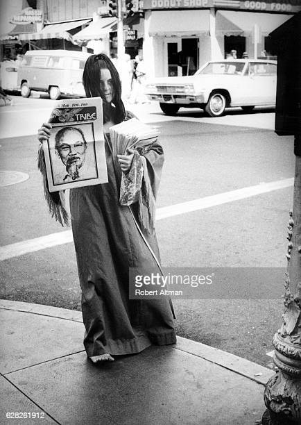 Paper Girl selling the Berkeley Barb on the street circa 1970 in Berkeley California
