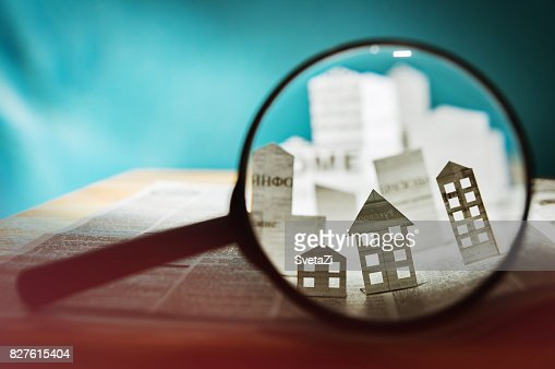 Paper house under a magnifying lens : Stock Photo