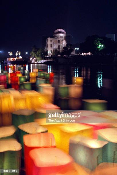 Paper lanterns are afloat on the Motoyasugawa River to commemorate the victims on the 50th anniversary of the atomic bomb dropped on August 6 1995 in...