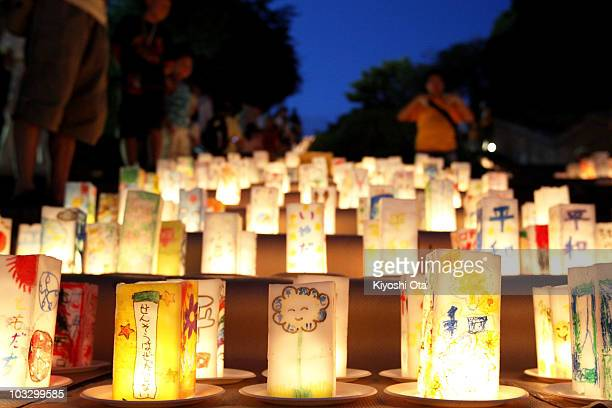 Paper lanterns are displayed for world peace and the atomic bomb victims at Nagasaki Peace Park on the eve of the 65th anniversary of the Nagasaki...