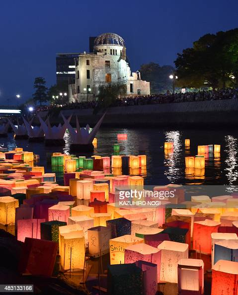 Paper lanterns float on the Motoyasu River in front of the Atomic Bomb Dome in Hiroshima on August 6 2015 Tens of thousands gathered for peace...