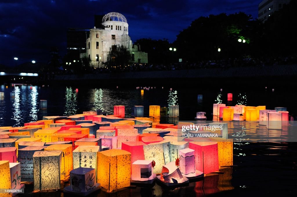 Paper lanterns to mourn the atomic bomb victims float in the Motoyasu River in front of the Atomic Bomb Dome (in background) in Hiroshima on August 6, 2011. Marking the 66th anniversary of the world's first atomic bombing at an annual event usually devoted to opposing nuclear weapons earlier in the day, Prime Minister Naoto Kan said the ongoing Fukushima crisis meant Japan must turn to other energy sources. AFP PHOTO / Toru YAMANAKA