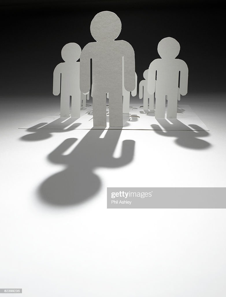 paper man standing in front of a group : Stock Photo