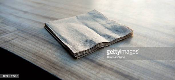 Paper napkins on a wooden table