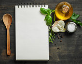 paper notebook and food ingredients, top view