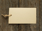Paper notes on rope on wooden background. Copy space.