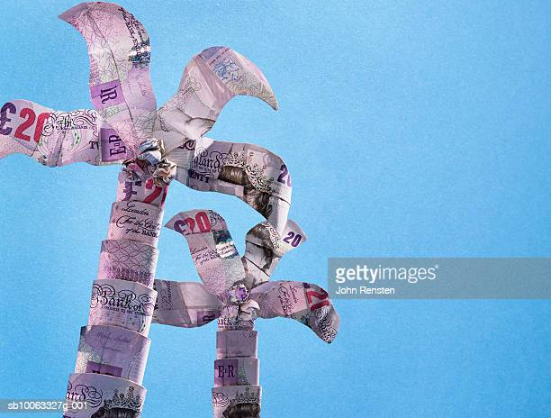 Paper palm trees made from twenty pound banknotes