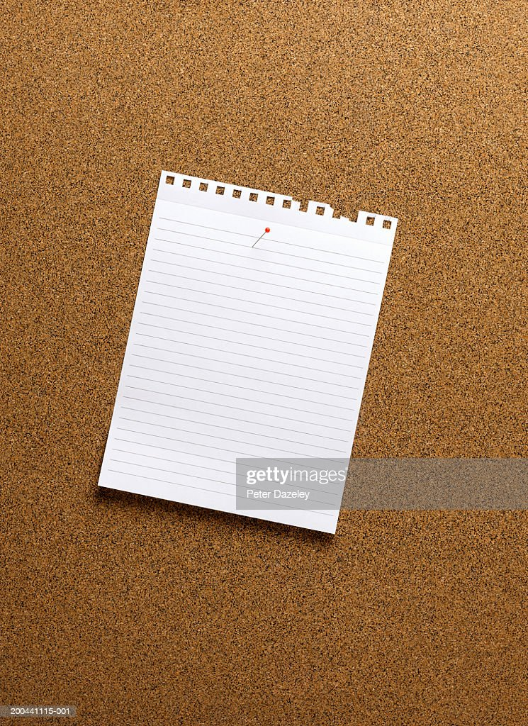 Paper pinned to notice board, close-up : Stock Photo