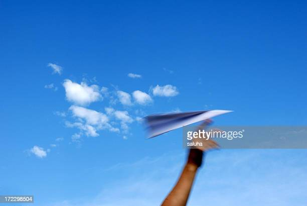 A paper plane soaring through the sky