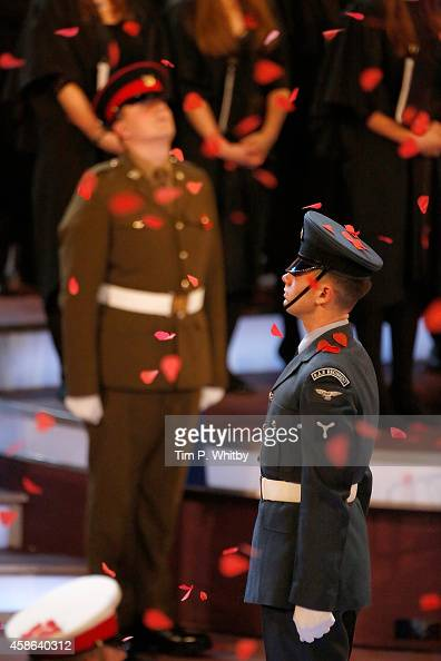 Paper poppy leaves fall onto participants during The Royal British Legion's Festival of Remembrance at Royal Albert Hall on November 8 2014 in London...
