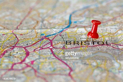 Paper road map with thumbtack marking Bristol