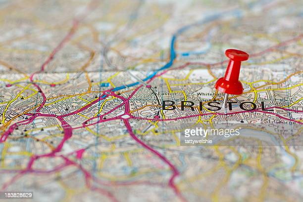 Paper road map with thumbtack marking Bristol