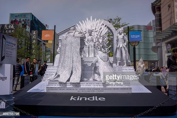 Paper sculpture of the novel A song of ice and fire attracts a lot of pedestrians on the Wangfujing street The Chinese eedition of the book will be...