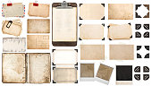 Used paper sheets, book, old photo frames and corners, antique clipboard. Vintage office objects isolated on white background.