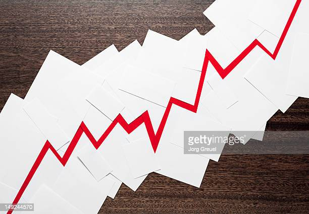 Paper sheets forming a financial graph