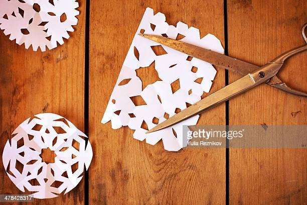 Paper snowflakes and scissors