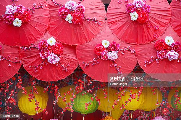 Paper Umbrella and lanterns on shopfront in Chinatown.