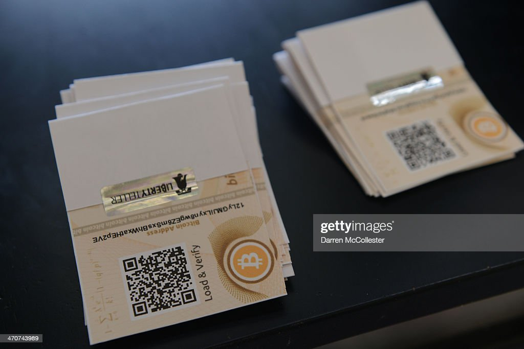 A 'paper wallet' is seen beside a newly installed Bitcoin ATM at South Station February 20, 2014 in Boston, Massachusetts. The ATM was placed by Liberty Teller to help inform people about the digital currency, which can be bought and sold anonymously, and can be used at a number of online retailers in place of cash or credit cards.