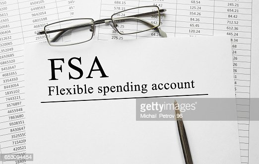 Paper with Flexible Spending Account FSA on a table : Stock Photo